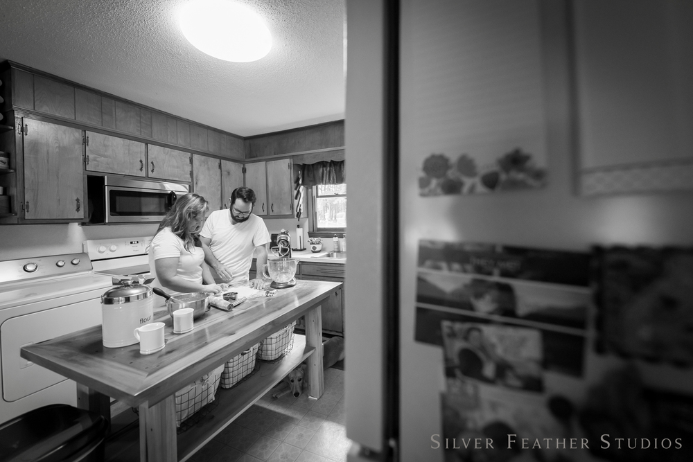 a lifestyle session making donuts together in their kitchen © silver feather studios, engagement photographer in greensboro