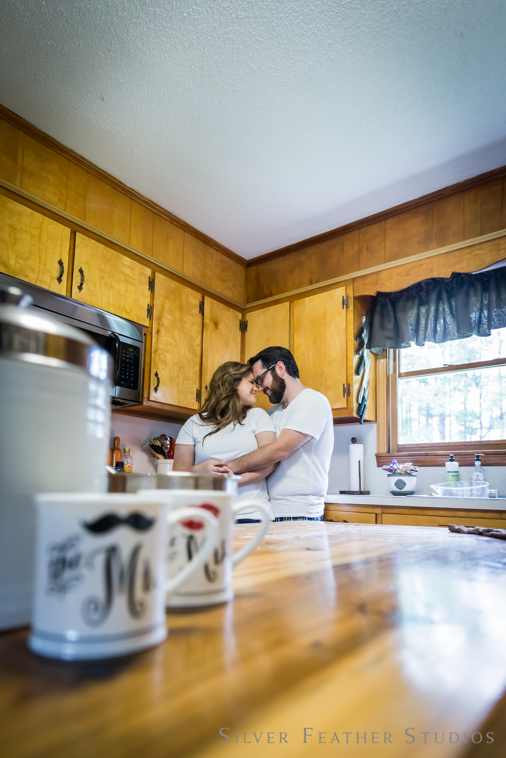 home lifestyle session featuring cuddles and coffee. © silver feather studios | wedding photography in burlington