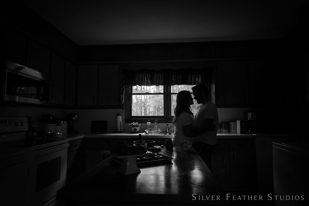 silhouette of jordan and heather at their home lifestyle session © silver feather studios | lifestyle photography in burlington