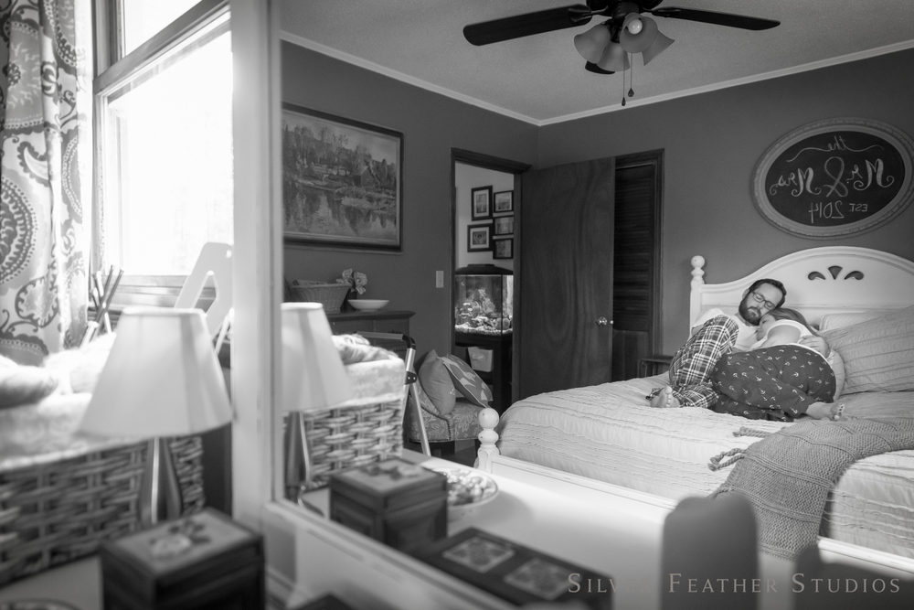 curled up in bed together | jordan and heather © silver feather studios | lifestyle photography in burlington