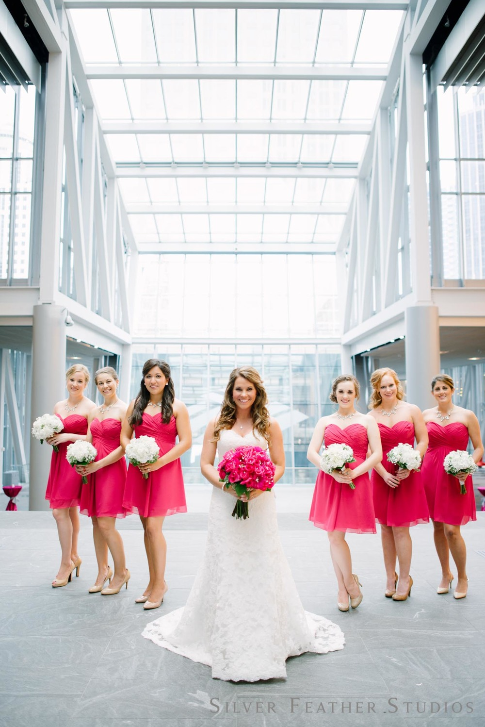 Charlotte wedding at the urban garden addison ashley the bridal party in strapless fuchsia knee length dresses at the ritz carlton silver ombrellifo Gallery