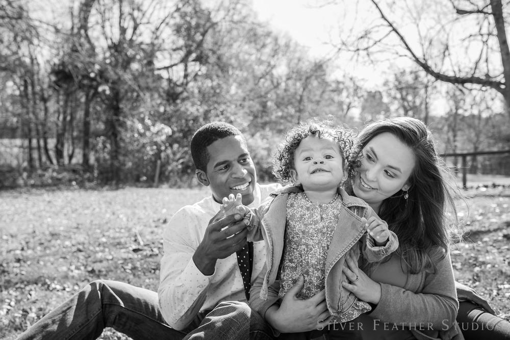 family photographs on a blanket at cedarock park in burlington, north carolina. © Silver Feather Studios