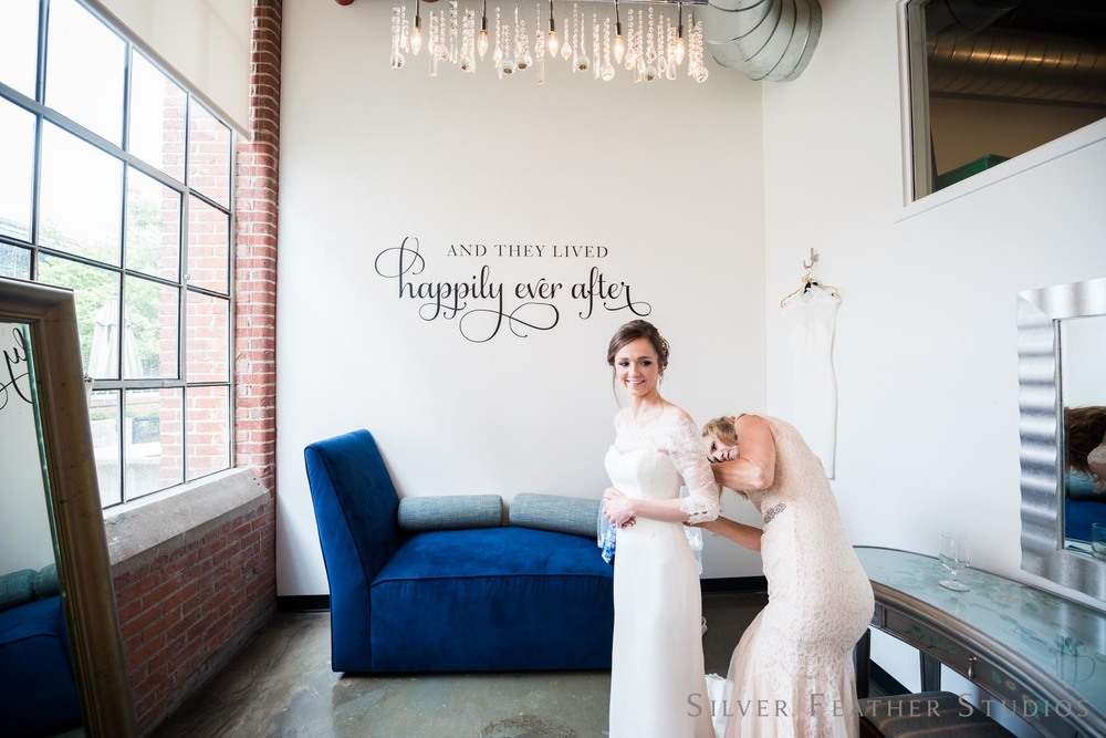 Anna getting ready for her Cotton Room wedding in Durham. © Silver Feather Studios, Burlington wedding photographer