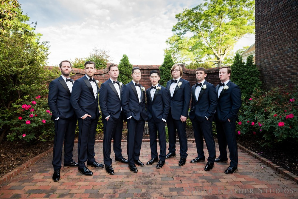 black tuxedos with bowties at Jeremy and Anna's classy wedding in Durham. © Silver Feather Studios