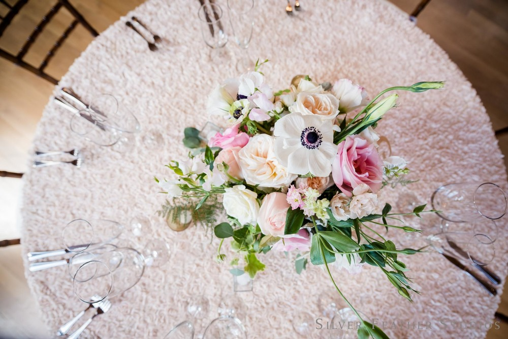 floral centerpieces by Mew Designs in Durham, NC © Silver Feather Studios, Cotton Room wedding photography