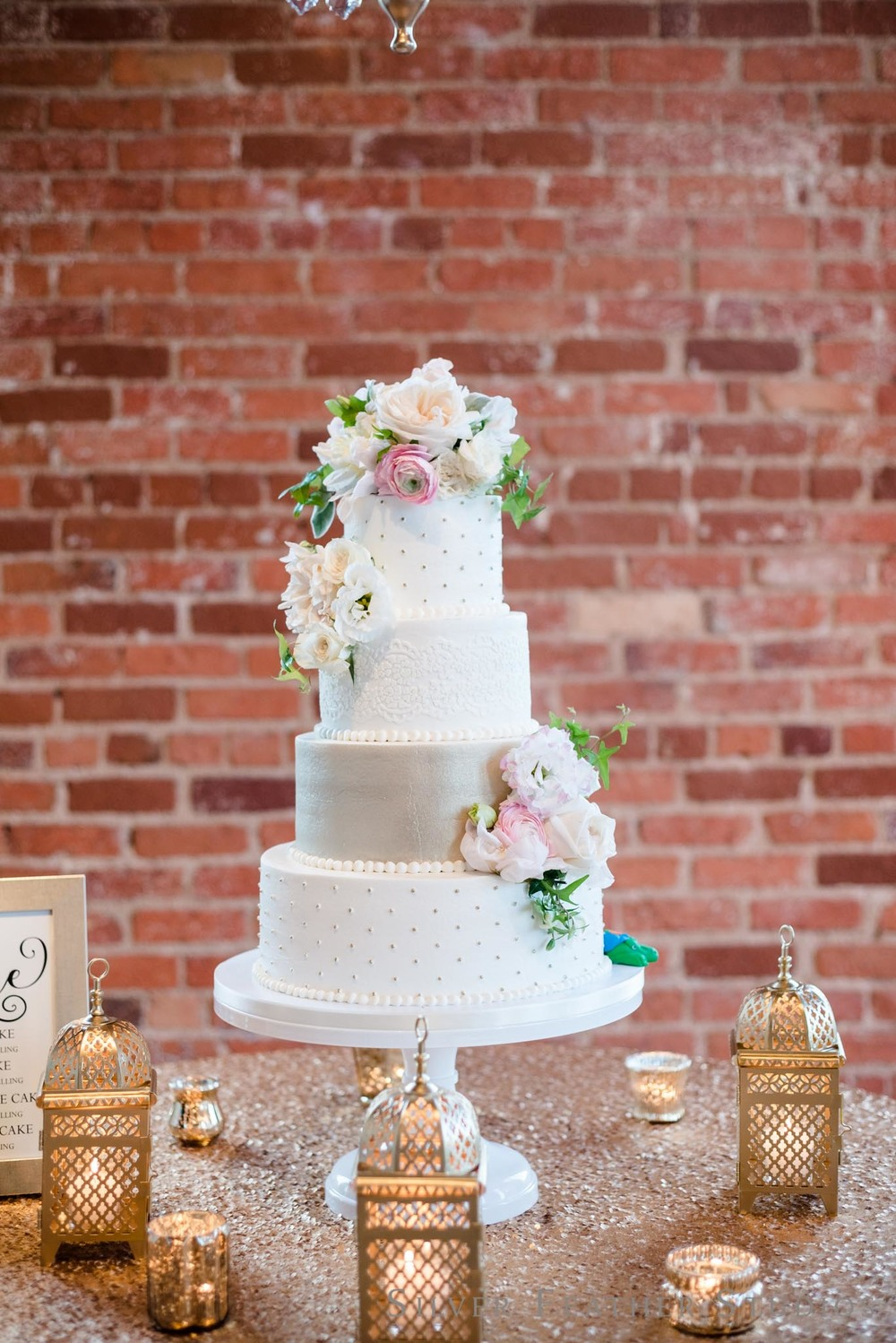 Four tier champagne colored wedding cake by Ashley Cakes in Durham, NC. © Silver Feather Studios, wedding photographer in Durham