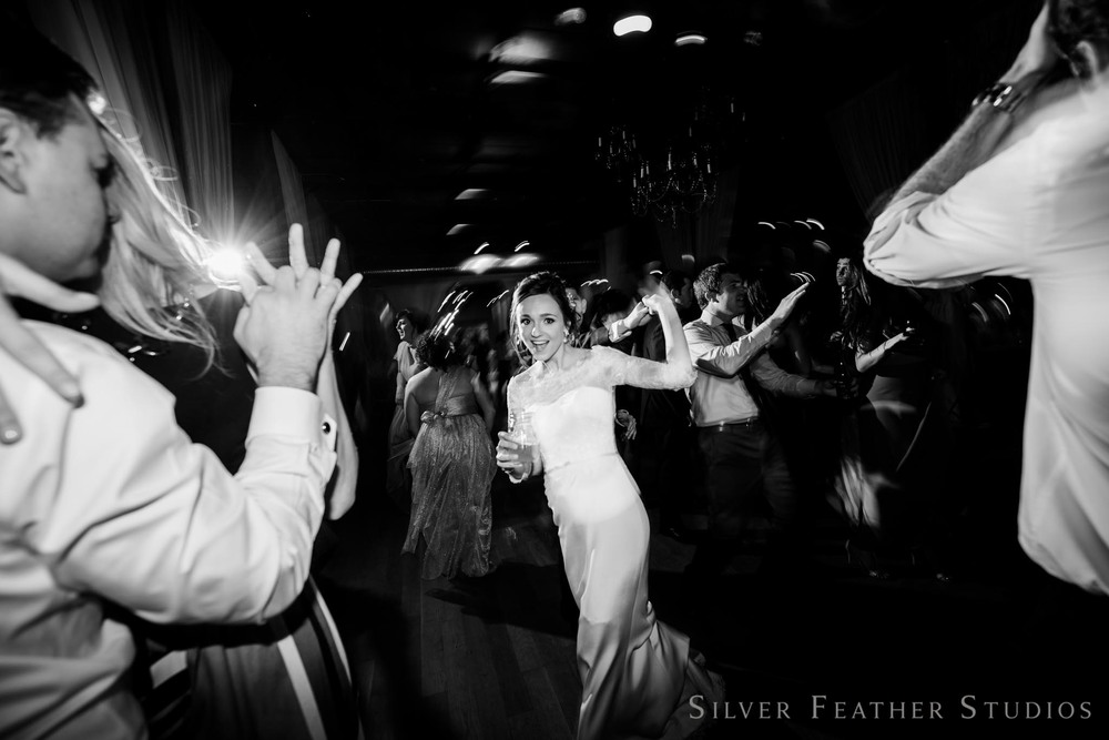 fun and spontaneous moments at this cotton room reception. © silver feather studios