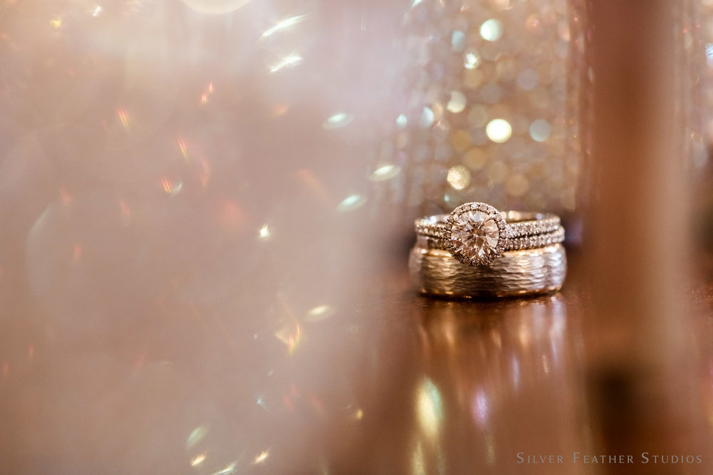 Wedding bands and rings with sparkly wedding shoes. © Silver Feather Studios, NC couples & lifestyle photography