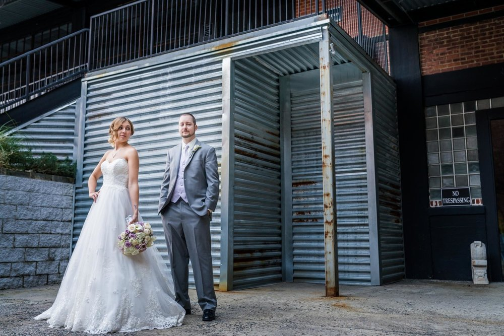 Reviews for Silver Feather Studios | Lofts at Union Square wedding photography.