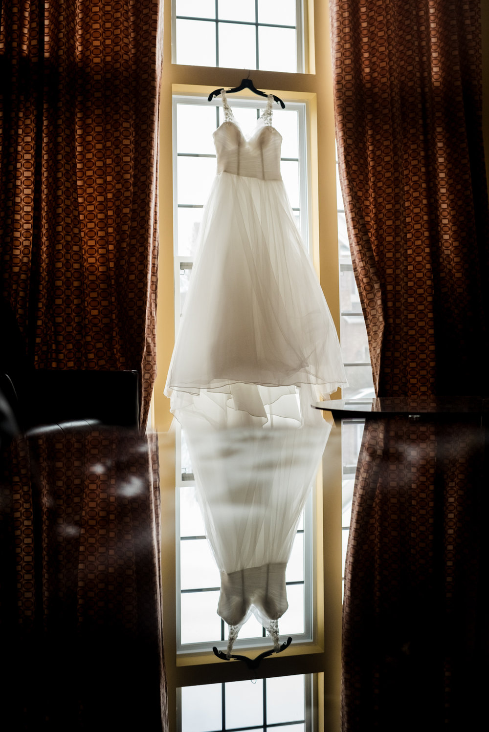 bride's wedding dress hanging at a home in gibsonville, nc. | greensboro wedding photographer
