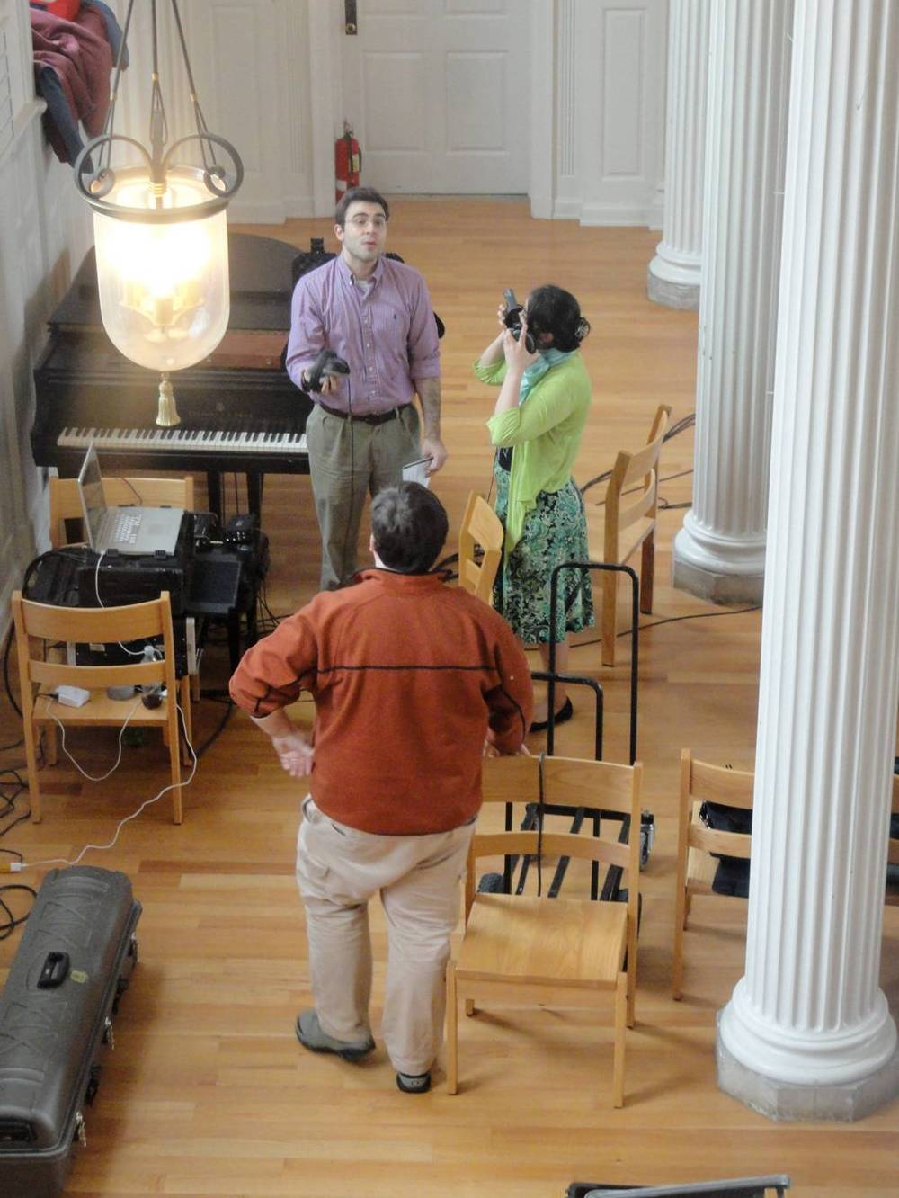 Derek and Grace discuss a take with engineer Mateusz Zechowski in Marquand Chapel, Yale Divinity School
