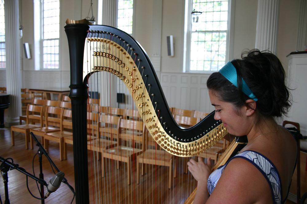 "Grace Cloutier tunes her harp before recording Prokofiev's ""Prelude"""
