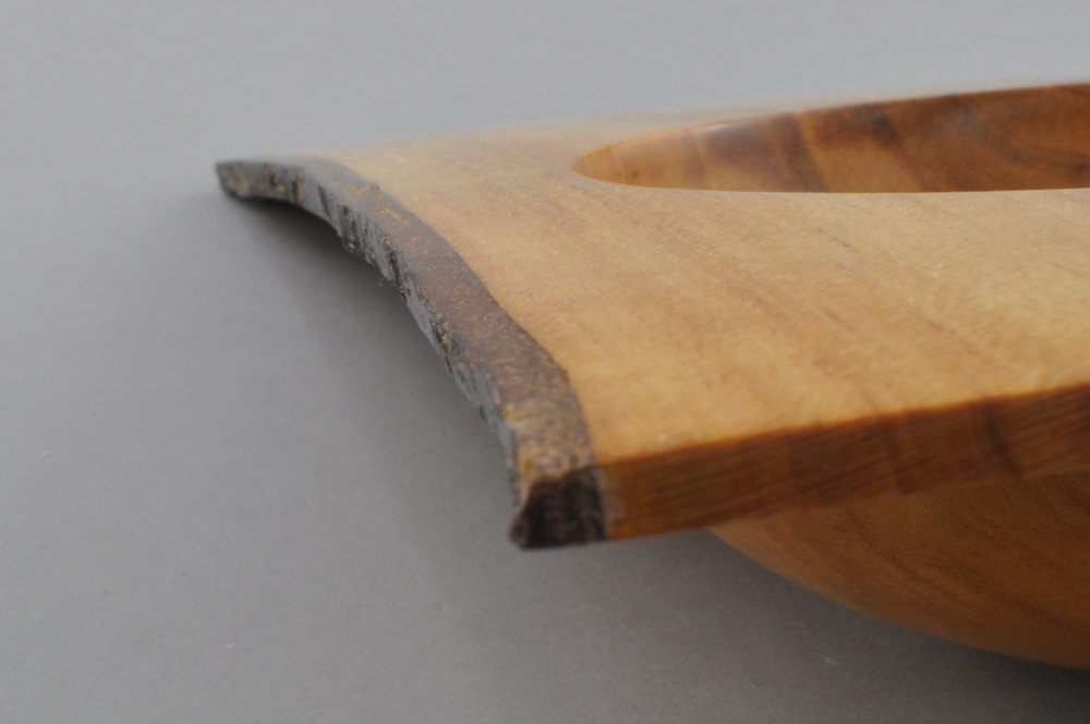 Natural edge on a winged bowl