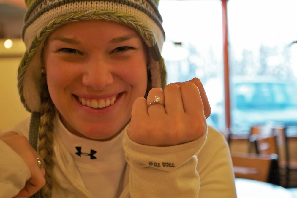 Kristin showing off the ring in a coffee shop in Fairbanks