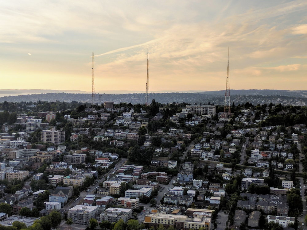 Sunset over Queen Anne hill looking down from the Space Needle.