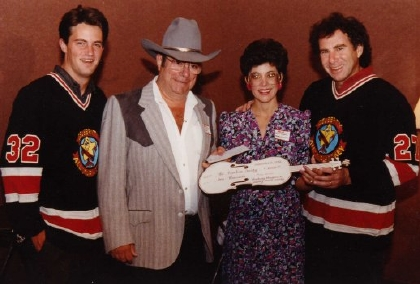 1989 - Chuck Skinner receiving Imperial Oil donation