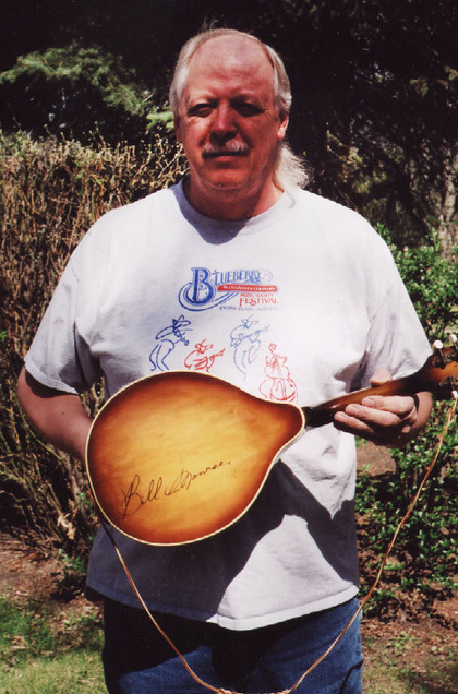 1995 - Jim Storey with his mandolin signed by Bill Monroe