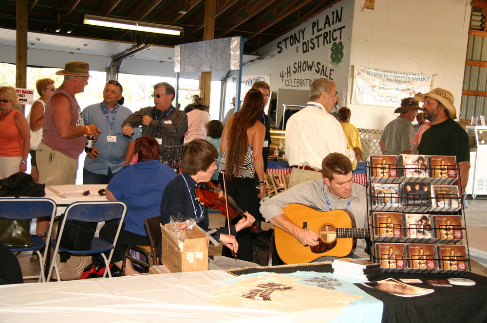 2009 - Autograph tables - Christian Ward & Clay Hess of Sierra Hill & Highway 111 with John Reischman in the background