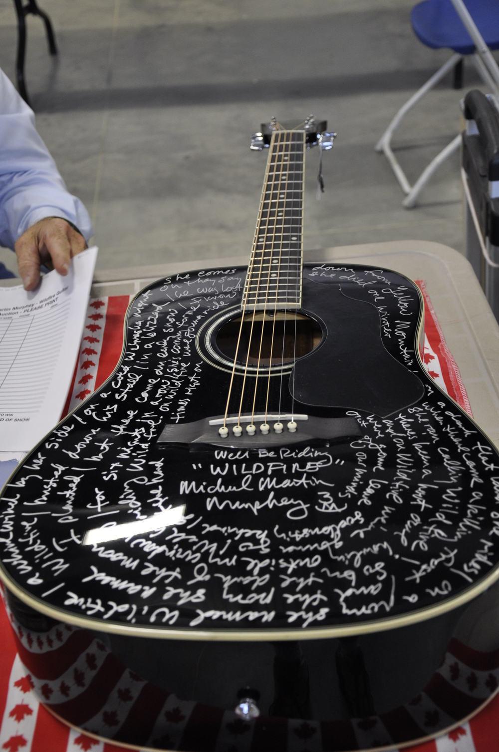 2012 - Silent auction guitar with Michael Martin Murphey's handwritten lyrics to Wildfire