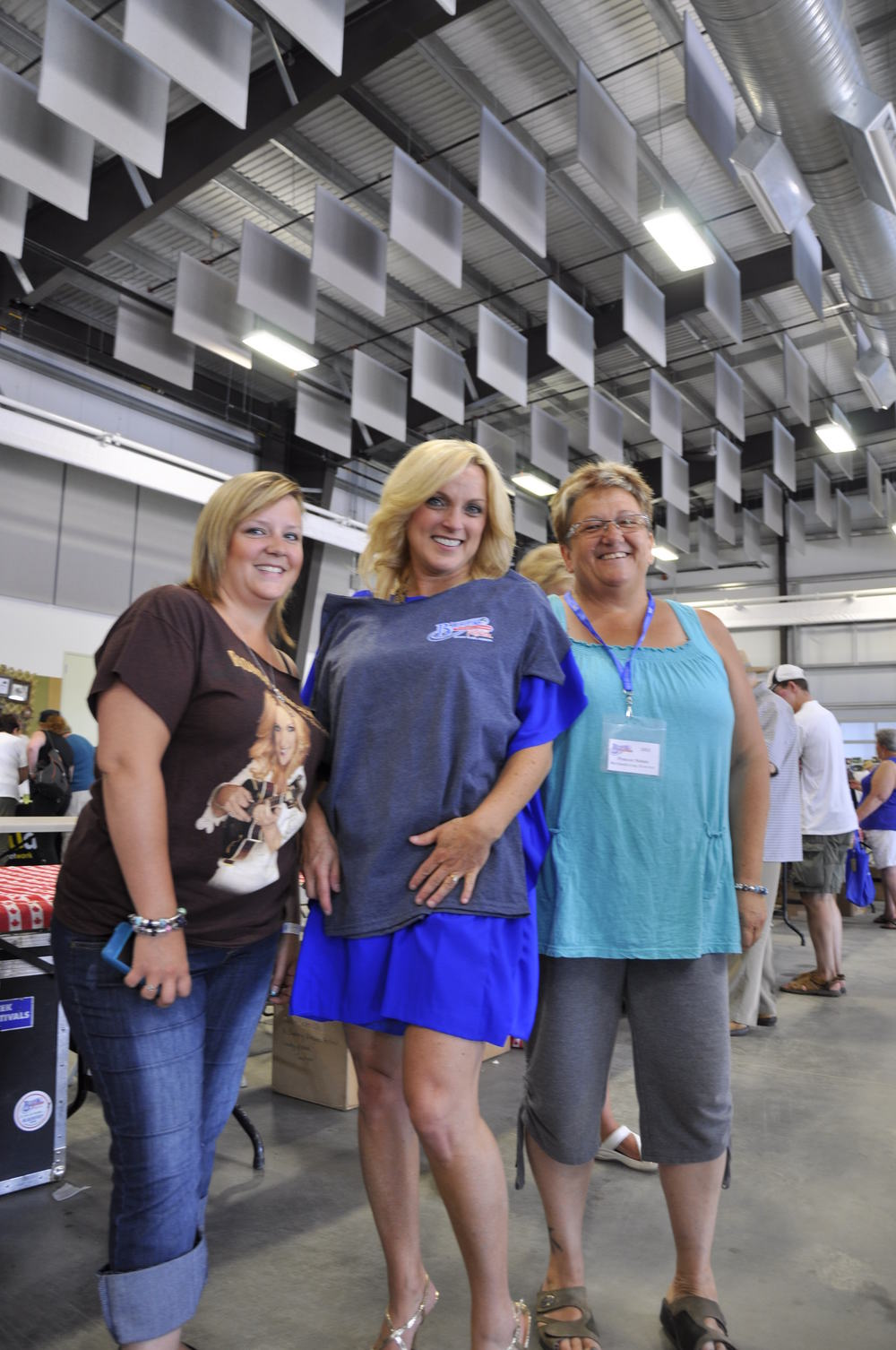 2012 - Rhonda Vincent receiving a Blueberry T-shirt from Blueberry Volunteer Francie Sobon & her daughter