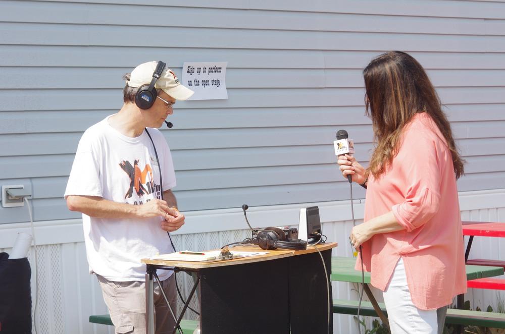 Donna Ulisse doing a radio interview with XM105 Whitecourt