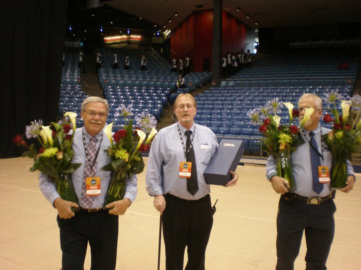 Jim (center) with fellow WGI administrators at the WGI World Championships.