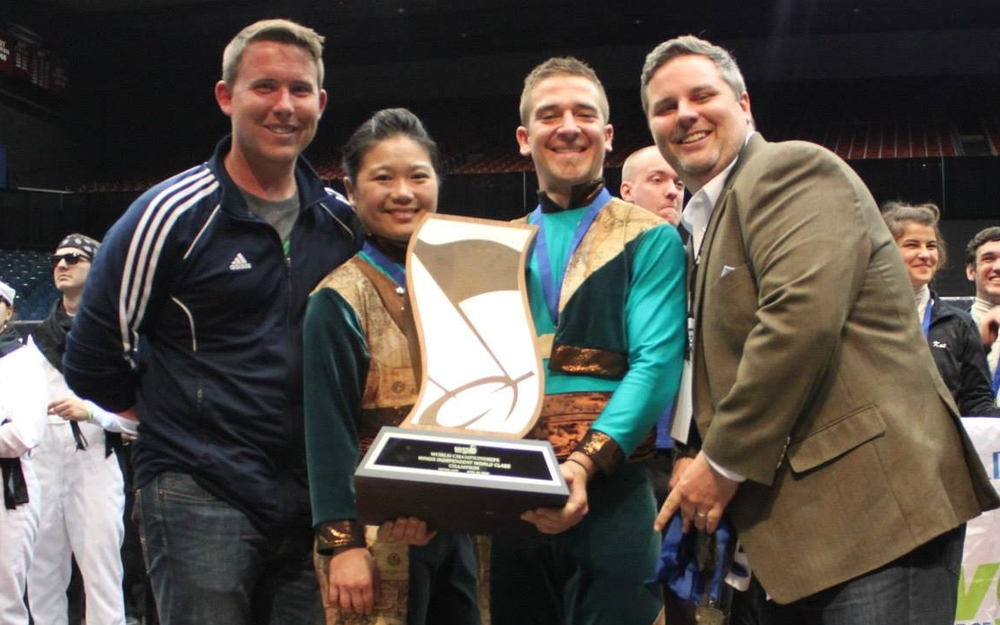 Stephen Mason (far left) and Jimmy Blankenship (far right) pose with X16 Winds cast members after their inaugural world championship.