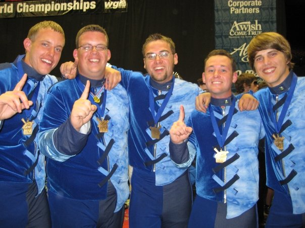 Jules Scogna (#196), second from right, poses with other marimba players after Rhythm X won the PIW Gold Medal in 2009.