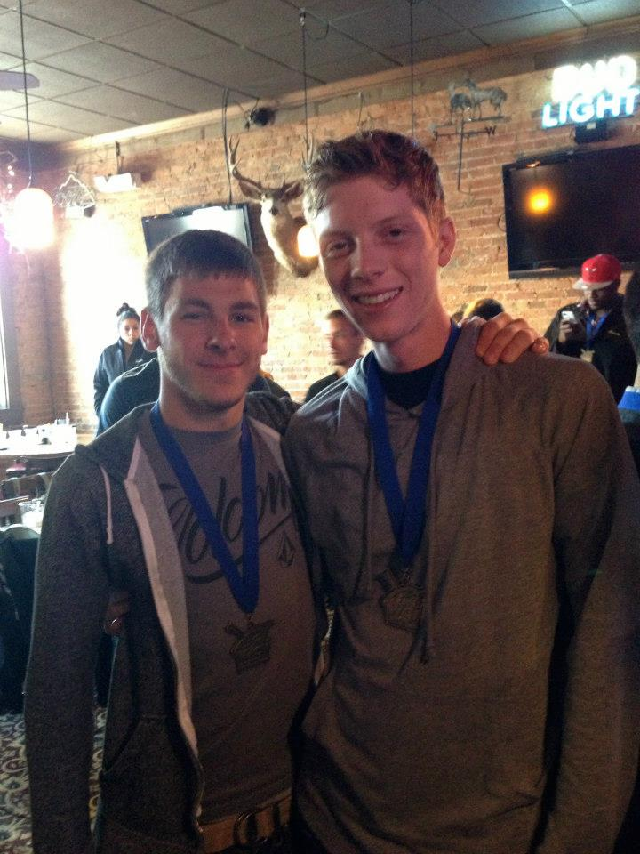 Frank Cummings (#274), left & Michael Tant (#311), right take a photo at the Rhythm X banquet following their 2013 WGI Percussion win.