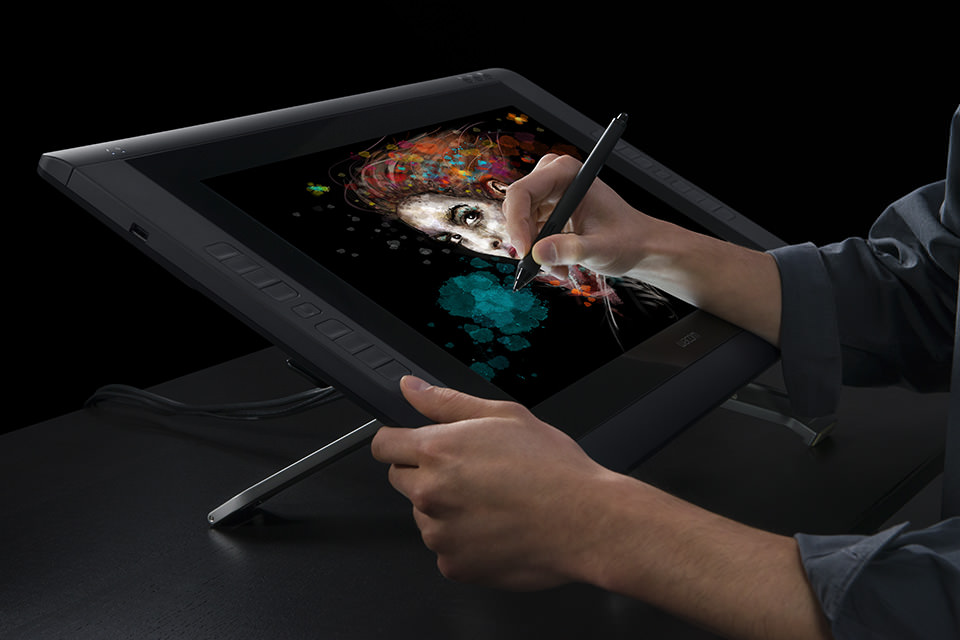 The large 22 inch screen of my new Cintiq 22HD Touch.(This photo isn't me either.)