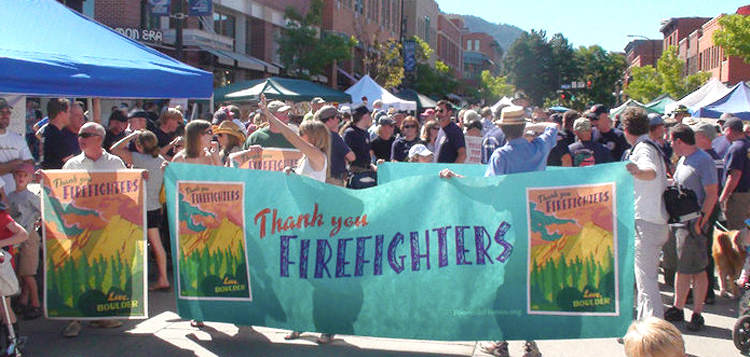 A firefighter parade marched through downtown Boulder with my art as the headlining banner.