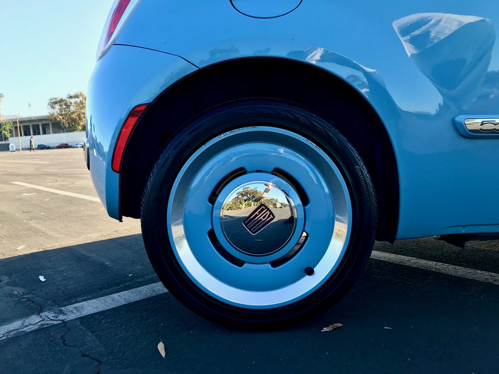 The classic paint-matched dome wheel rims give it a distinct, classy look. People compliment the rims as much as the car.