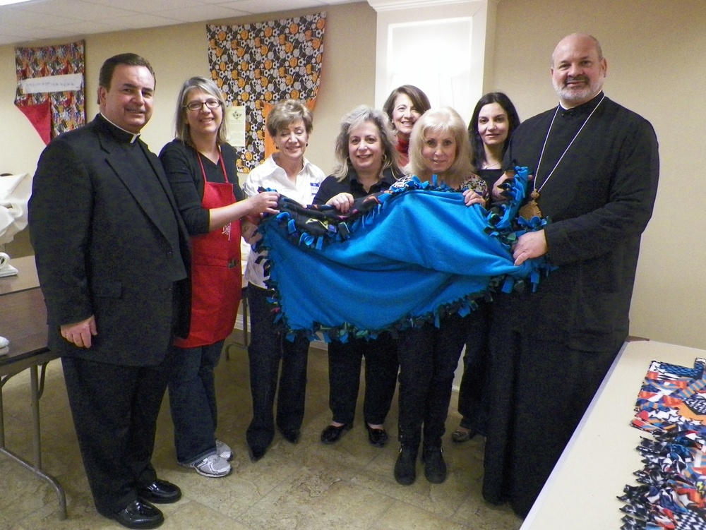 Pictured (from left) at the Lenten Quilt-a-thon recently hosted by the Philoptochos Society of Saints Peter and Paul Greek Orthodox Church in Glenview: Fr. James Dokos, protopresbyter of the church; event co-chair Karen Venson; several Quilt-a-thon participants and His Grace Bishop Demetrios of Mokissos, Chancellor of the Chicago Metropolis.