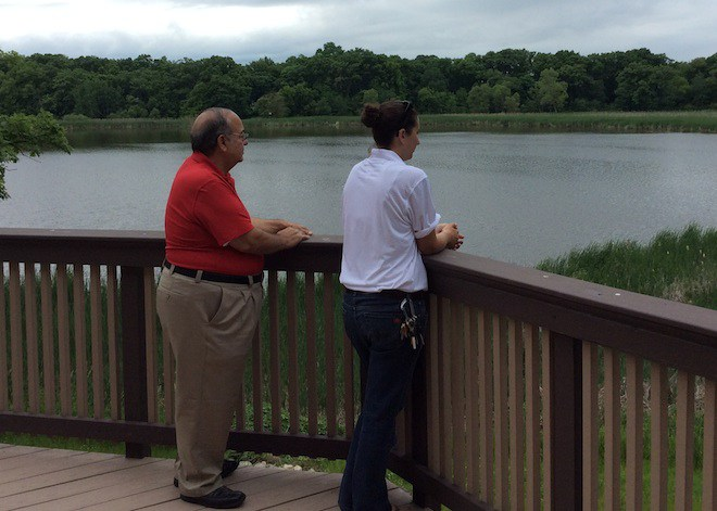 Bill J. Vranas, the president of the St. Iakovos Retreat Center Board, and Chrysanthy Tiggas, the director for the center, look out over the lake adjourning the center in Kansasville.
