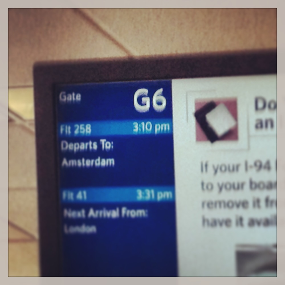 My gate number was so auspicious that I had to get a photo (albeit an unfocused one).  Unfortunately the flight that I switched to out of Minneapolis was entirely full.  Trying to sleep on a 9hr flight in an aisle seat without letting by-passers bump your head? Yikes.