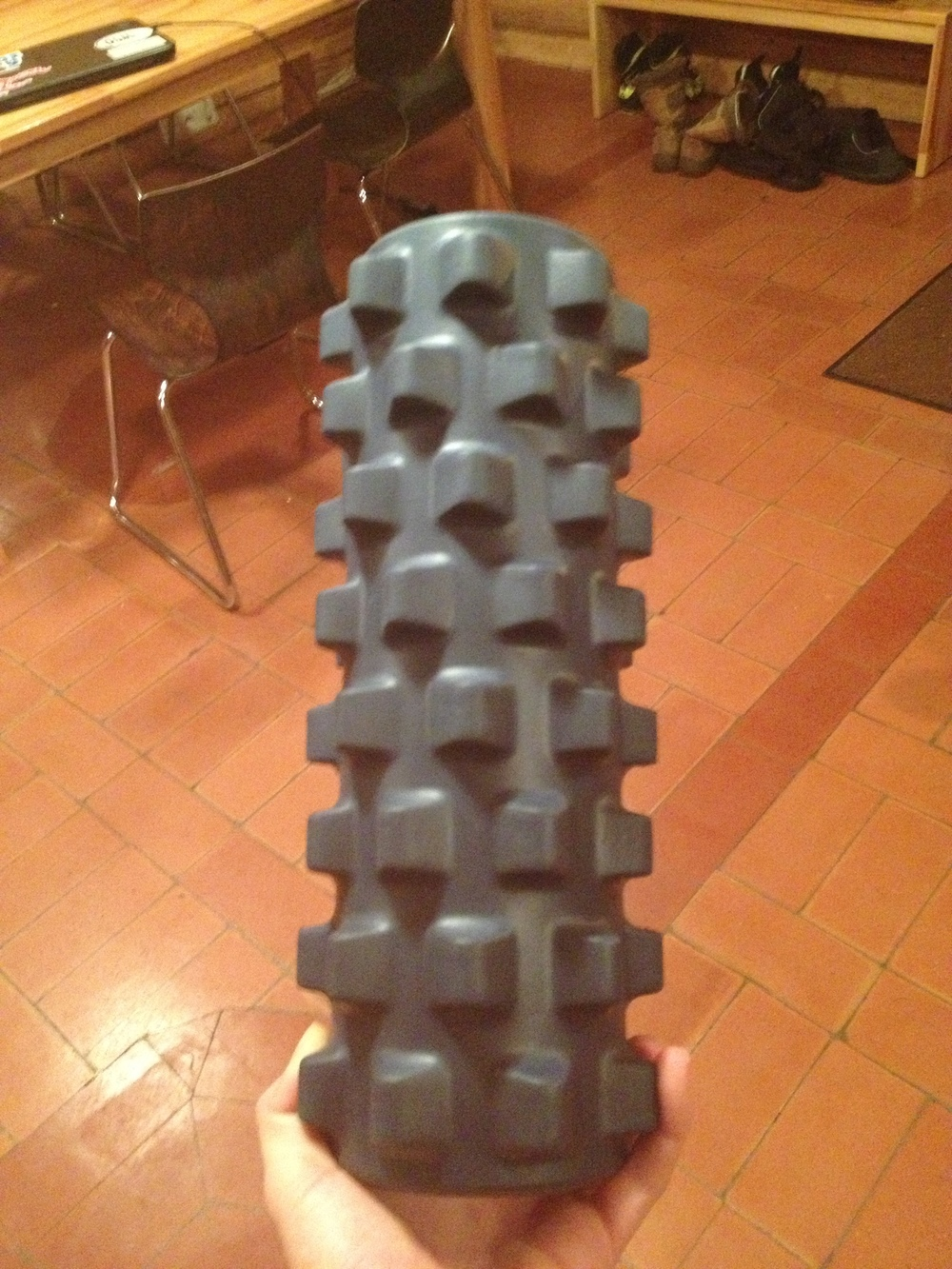 Jennie's torture-rolling device. I suppose those knobby bits are good for your muscles, but...