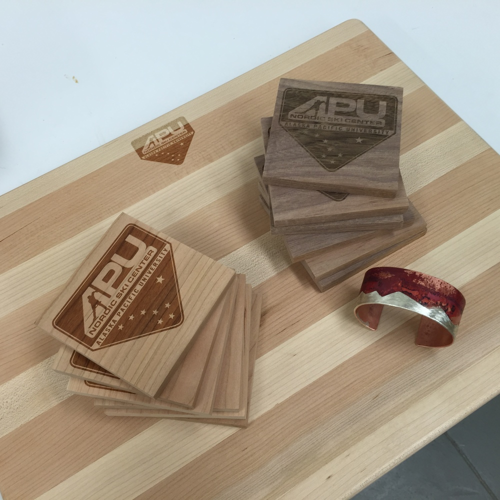 A handmade cutting board, drink coasters, and cuff bracelet.  The wood products are laser-engraved with the APUNSC logo, so they're one-of-a-kind auction items.  Make sure to check them out on May 8th at the APU Atwood building, where they will be available to bid on!  Those cuff bracelets are also definitely unique because no oxidation pattern is ever the same, so if you like it you'd better put a bid on it... just saying.