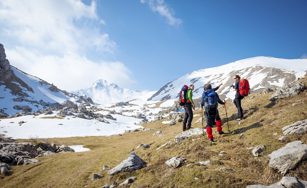 Image of three people climbing a snowy mountain - Vision and Mission