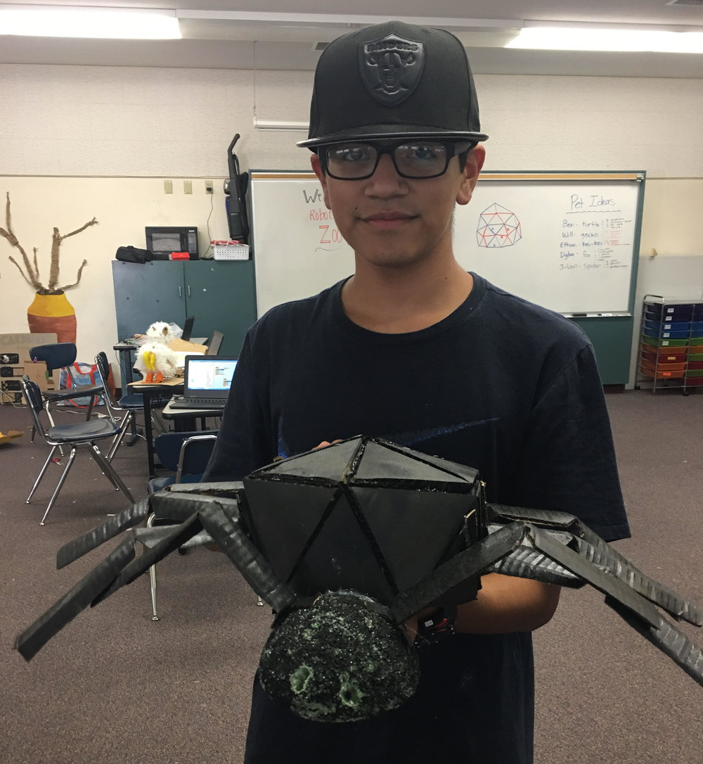 One of our students with his Animatronic Spiders.