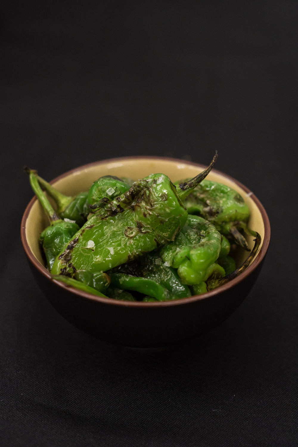 PIMIENTOS DE PADRON - blistered padron peppers