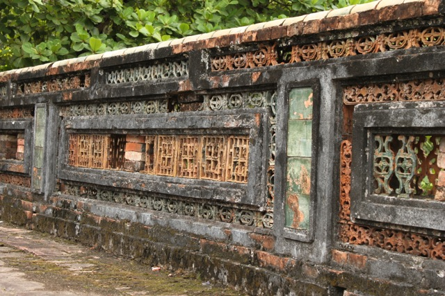 The blend of old and new.   Historic tombs, temples and gates co-existing with modern development.