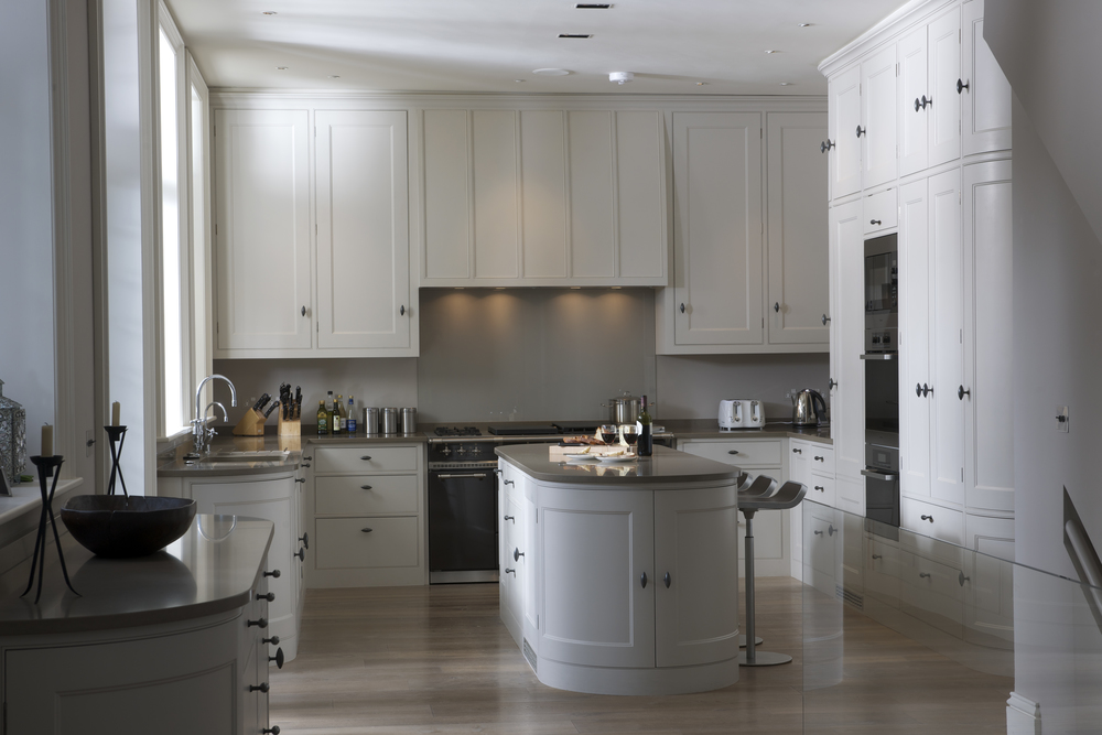 Swiss Cottage kitchen with panel doors set in a beaded frame, finished in Farrow & Ball 'Skimming Stone' Estate Eggshell, Lincoln Pull handles in patine, Caesarstone 'Ginger' worktop, Lacanche Range cooker