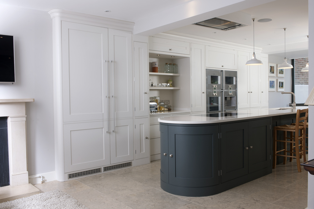 A dark island combined with light wall cabinetry give drama and contrast