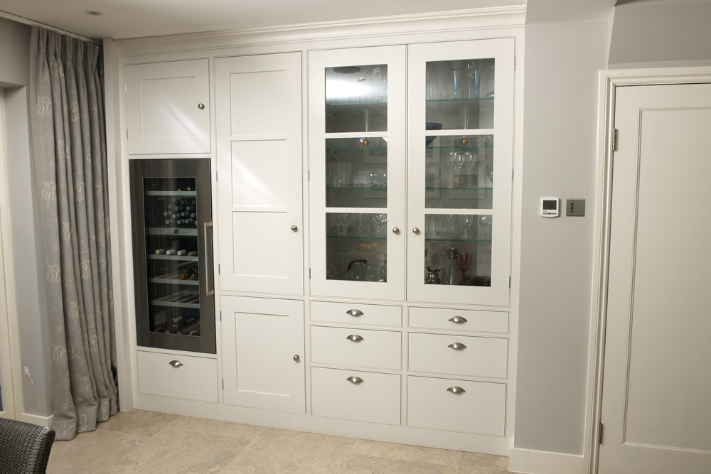 In-built wine cooler and elegant glazed display cupboard