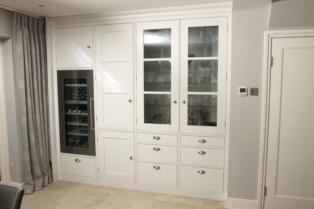 In-built wine cooler and elegant glazed display cupboard