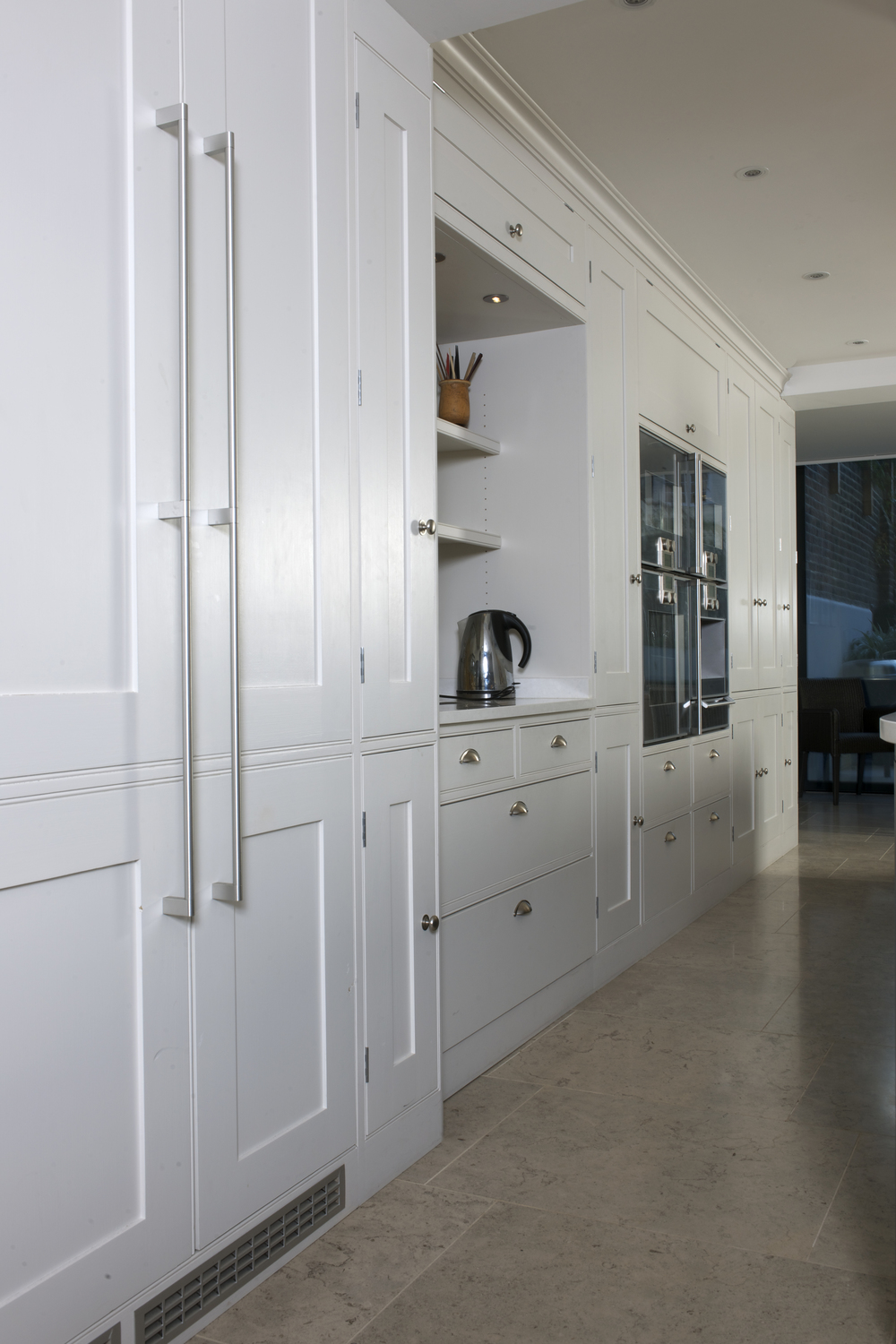 Elegant and highly functional bank of wall cupboards