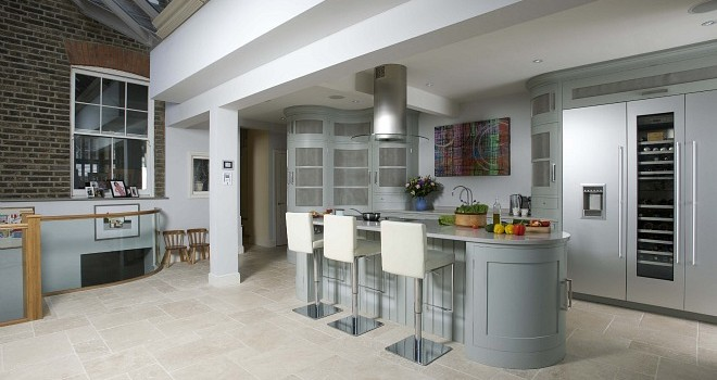 Curves and stainless steel mesh are trademarks of Tim Moss kitchens