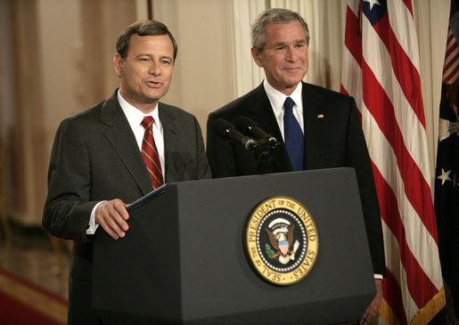 Chief Justice John Roberts (left) with former President George W. Bush at a press release in 2005 (Courtesy of the White House).