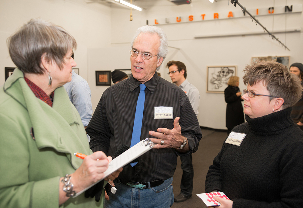 Professor and Department Chair Steve Mayse talking with patron Cindy Kunz about the show. (That's me, prof Maura Cluthe, on the right ready with some red dots. I was more than happy to place red dots on some pieces that night!)