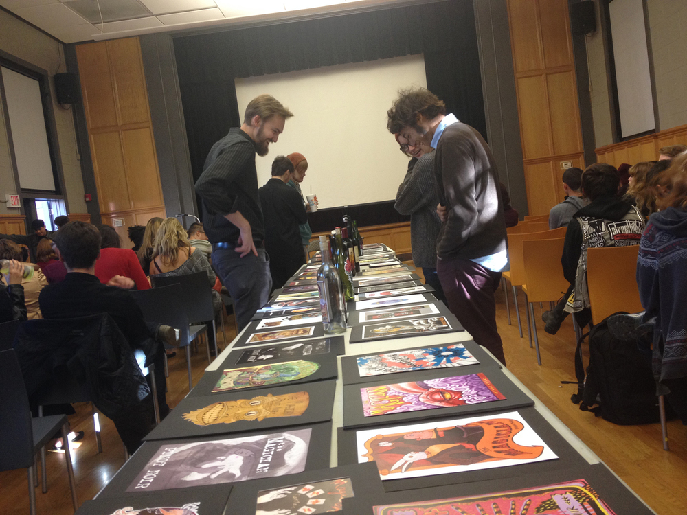Students looking through all the artwork that was done for Victo's assignment